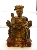 Statue of Chinese dignitary seated on a throne
